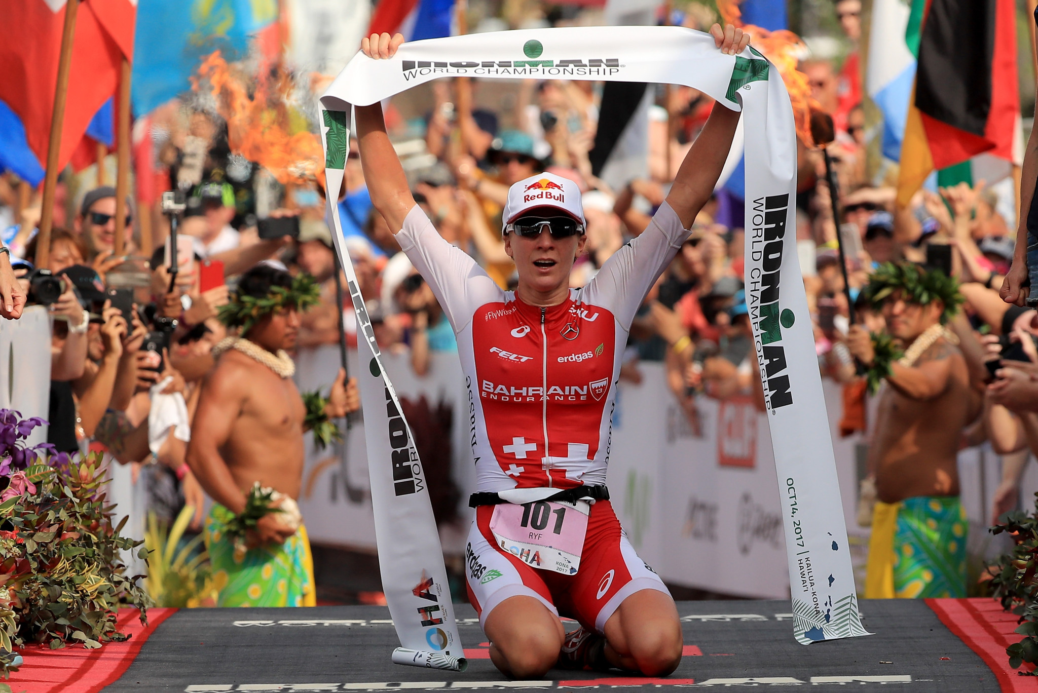 KAILUA KONA, HI - OCTOBER 14:  Daniela Ryf of Switzerland celebrates after winning the IRONMAN World Championship on October 14, 2017 in Kailua Kona, Hawaii.  (Photo by Sean M. Haffey/Getty Images for IRONMAN)